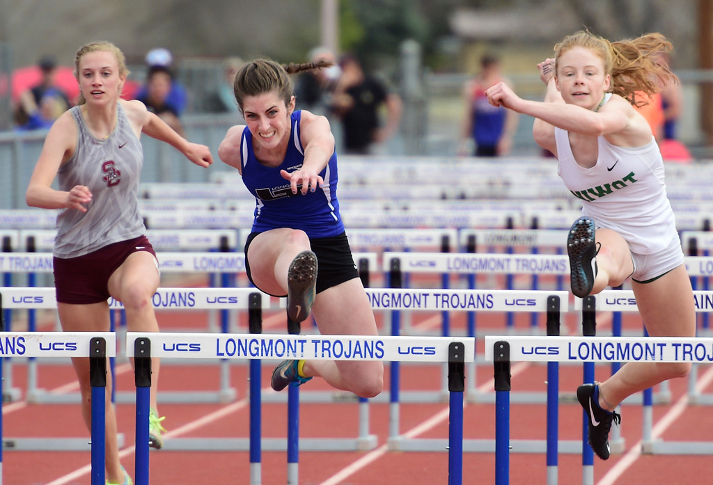. LONGMONT, CO - April 20, 2019: Tara Hitchcock, of Longmont, wins the 100 meter hurdles at the Boulder County Track and Field Championships in Longmont. (Photo by Cliff Grassmick/Staff Photographer)