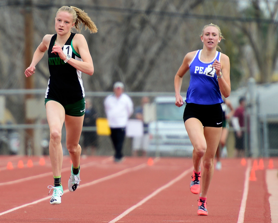 . LONGMONT, CO - April 20, 2019: Taylor James, left, of Niwot, pulls ahead of Quinn McConnell, of Peak to Peak, to win the 1600 meters  at the Boulder County Track and Field Championships in Longmont. (Photo by Cliff Grassmick/Staff Photographer)