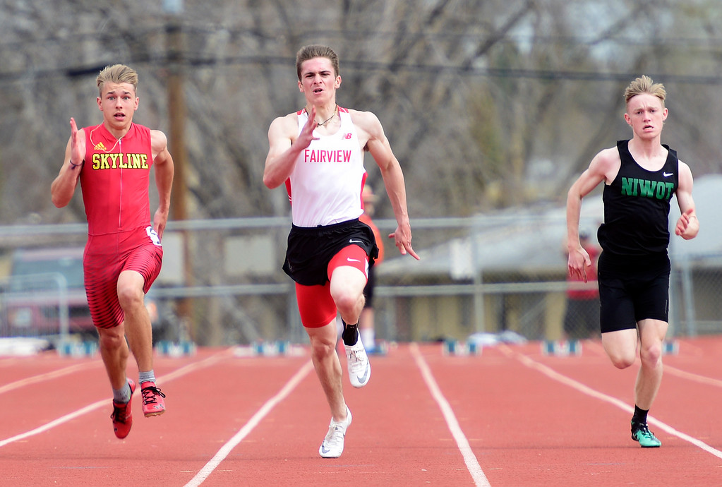 . LONGMONT, CO - April 20, 2019: Andrew Brown, left, of Skyline, Gavin Schurr, Fairview, and Emrik Wells, of Niwot, run in the 100 meters at the Boulder County Track and Field Championships in Longmont. (Photo by Cliff Grassmick/Staff Photographer)