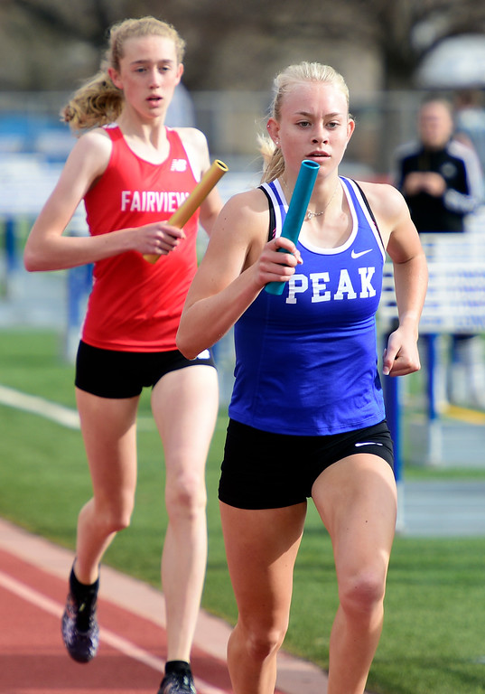 . LONGMONT, CO - April 20, 2019: Anna Shultz, right, of Peak to Peak, in the 4X800 relay at the Boulder County Track and Field Championships in Longmont. (Photo by Cliff Grassmick/Staff Photographer)