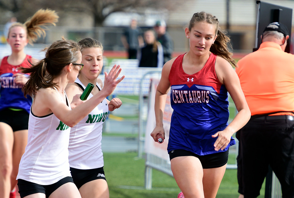 . LONGMONT, CO - April 20, 2019:  Brooke Calvo, of Centaurus, in the 4X800 meter relay at the Boulder County Track and Field Championships in Longmont. (Photo by Cliff Grassmick/Staff Photographer)