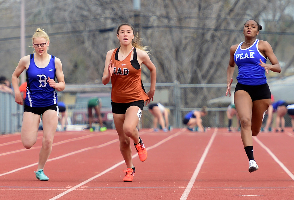. LONGMONT, CO - April 20, 2019:  Emma Alford, left, of Broomfield, Haley Williams, of Mead, and Makenna Turner, of Peak to Peak, in the 100 meters at the Boulder County Track and Field Championships in Longmont. (Photo by Cliff Grassmick/Staff Photographer)
