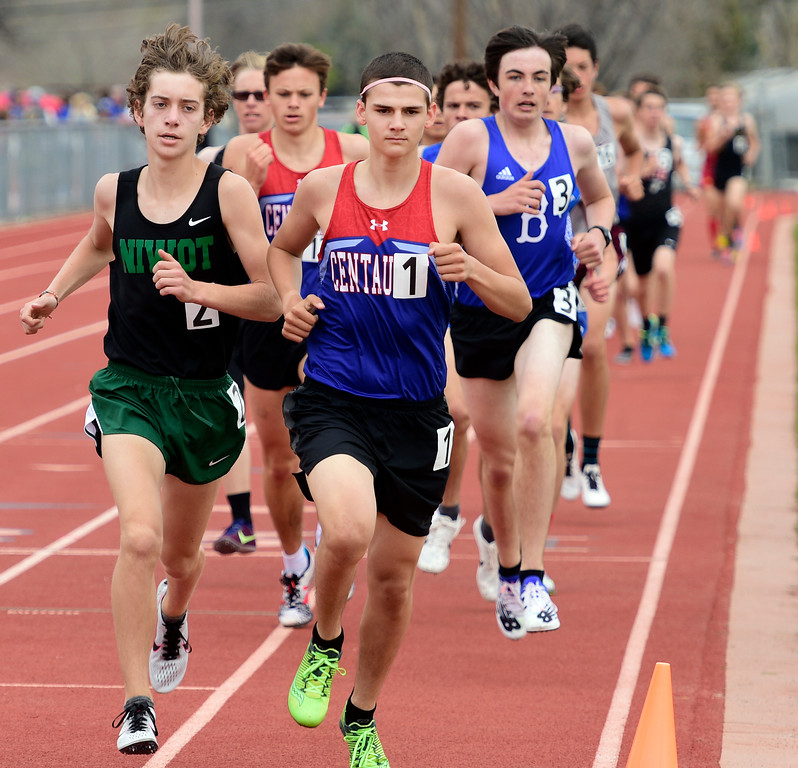 . LONGMONT, CO - April 20, 2019: Joey Hendershot, left, of Niwot, and James Overberg, of Centaurus, in the 1600 meters at the Boulder County Track and Field Championships in Longmont. (Photo by Cliff Grassmick/Staff Photographer)
