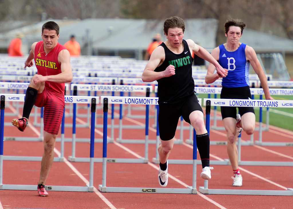 . LONGMONT, CO - April 20, 2019:  Nolan Jahan, center, of Niwot, wins the 110 meters hurdles at the Boulder County Track and Field Championships in Longmont. (Photo by Cliff Grassmick/Staff Photographer)