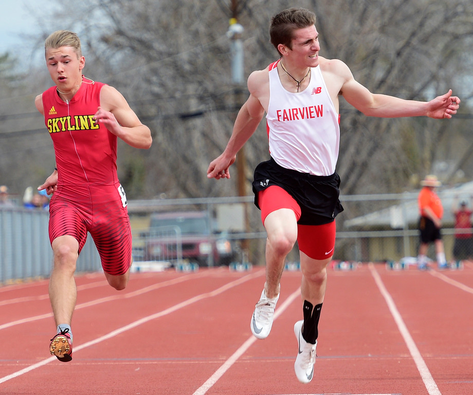 . LONGMONT, CO - April 20, 2019: Gavin Shurr, right, of Fairview, wins the 100 meters  at the Boulder County Track and Field Championships in Longmont. Andrew Brown, of Skyline, is on the left. (Photo by Cliff Grassmick/Staff Photographer)