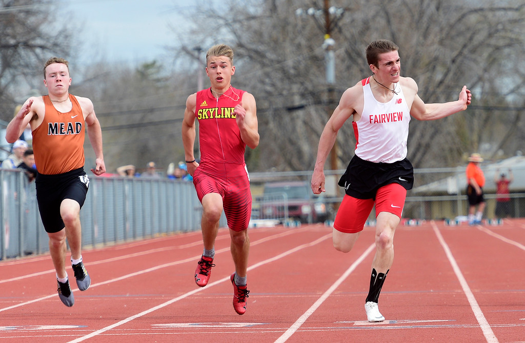 . LONGMONT, CO - April 20, 2019: Gavin Shurr, right, of Fairview, wins the 100 meters at the Boulder County Track and Field Championships in Longmont. (Photo by Cliff Grassmick/Staff Photographer)