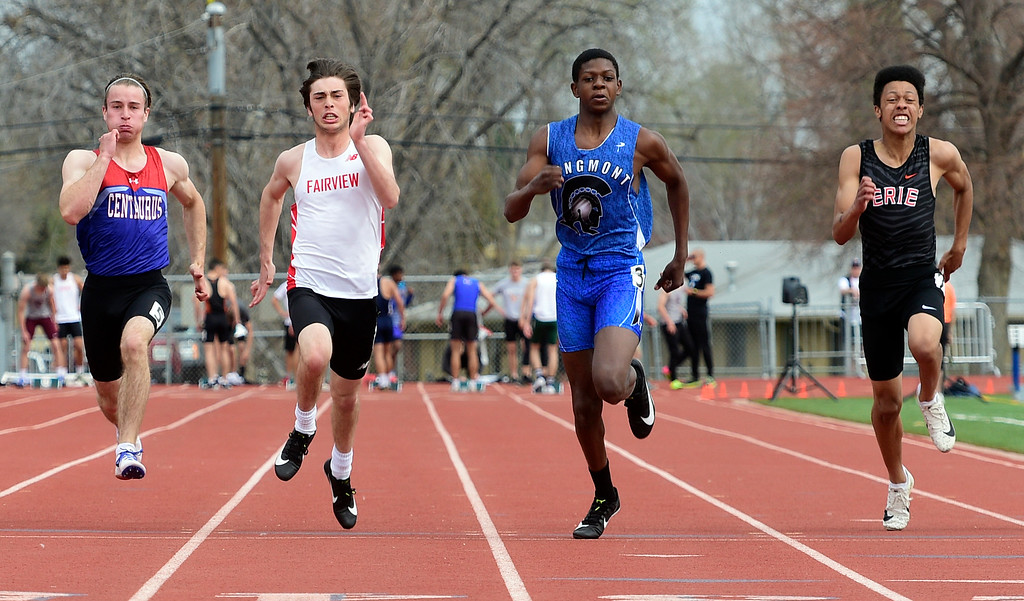. LONGMONT, CO - April 20, 2019: Ethan McAleavy, left, of Centaurus, Axel Rosen, of Fairview, Quinn Featherston, of Longmont, and Robert Welch, of Erie, on the 100 meters  at the Boulder County Track and Field Championships in Longmont. (Photo by Cliff Grassmick/Staff Photographer)