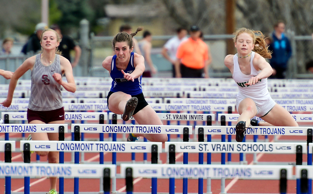 . LONGMONT, CO - April 20, 2019: Tara Hitchcock, center, of Longmont, wins the 100 meter hurdles   at the Boulder County Track and Field Championships in Longmont. (Photo by Cliff Grassmick/Staff Photographer)