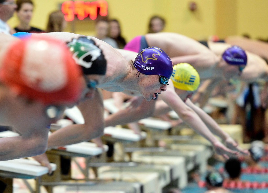 . THORNTON, CO - April 13, 2019:   CJ Turf, of Boulder, in the 100 butterfly during the 2019 Boys\' Mustang Invitational. (Photo by Cliff Grassmick/Staff Photographer)