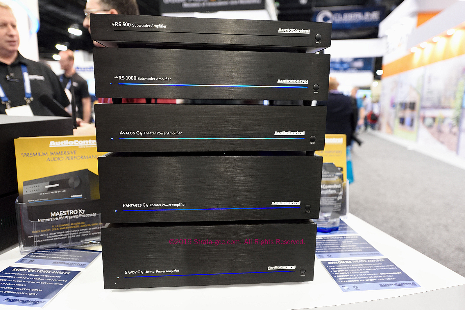 A stack of subwoofer and home theater amplifiers
