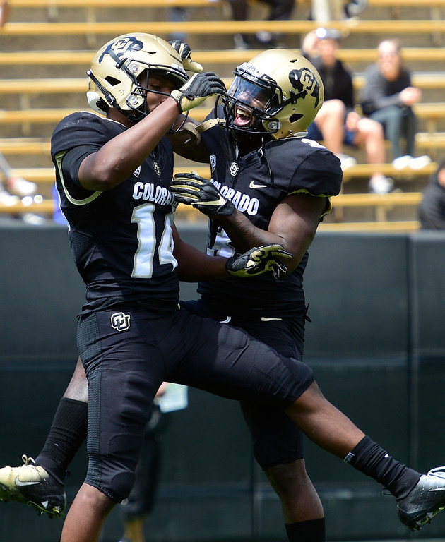 . Boulder, CO - April 27, 2019: Dimitri Stanley celebrates his TD catch with KD Nixon during the 2019 CU Football Spring Game on April 27, 2019. (Photo by Cliff Grassmick/Staff Photographer)