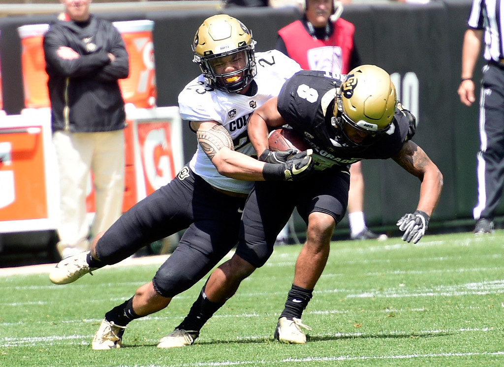 . Boulder, CO - April 27, 2019: Isaiah Lewis makes the tackle on Alex Fontenot during the 2019 CU Football Spring Game on April 27, 2019. (Photo by Cliff Grassmick/Staff Photographer)
