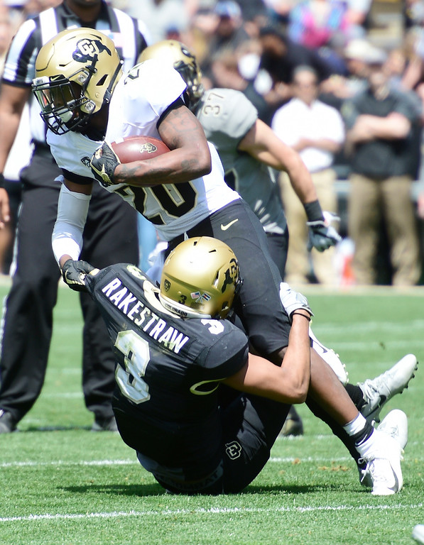 . Boulder, CO - April 27, 2019: Deion Smith tries to run through Derrion Rakestraw during the 2019 CU Football Spring Game on April 27, 2019. (Photo by Cliff Grassmick/Staff Photographer)