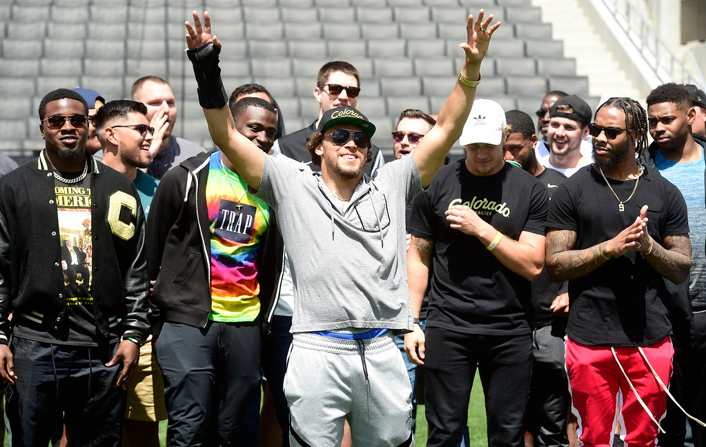 . Boulder, CO - April 27, 2019: Denver Bronco, Phillip Lindsay, waves to the crowd with other former Buffs in the NFL during the 2019 CU Football Spring Game on April 27, 2019. (Photo by Cliff Grassmick/Staff Photographer)