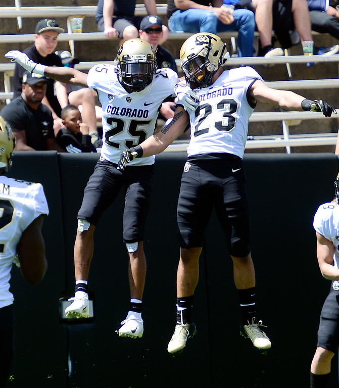 . Boulder, CO - April 27, 2019:  Mekhi Blackmon, left, and Isaiah Lewis celebrate a pick 6 for the Gold team during the 2019 CU Football Spring Game on April 27, 2019. (Photo by Cliff Grassmick/Staff Photographer)