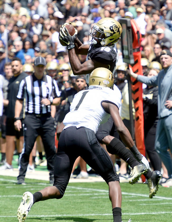 . Boulder, CO - April 27, 2019:  Tony Brown makes a catch over Delrick Abrams during the 2019 CU Football Spring Game on April 27, 2019. (Photo by Cliff Grassmick/Staff Photographer)