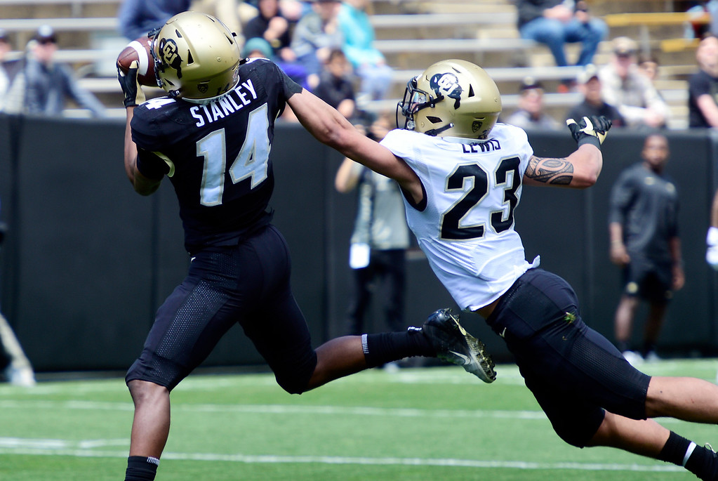 . Boulder, CO - April 27, 2019: Dimitri Stanley makes a TD catch over Isaiah Lewis  during the 2019 CU Football Spring Game on April 27, 2019. (Photo by Cliff Grassmick/Staff Photographer)