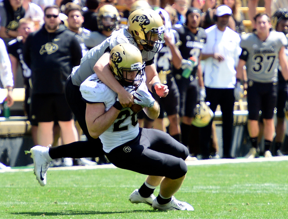 . Boulder, CO - April 27, 2019:  Carson Wells intercepts a pass meant for Steven Montez during the 2019 CU Football Spring Game on April 27, 2019. (Photo by Cliff Grassmick/Staff Photographer)