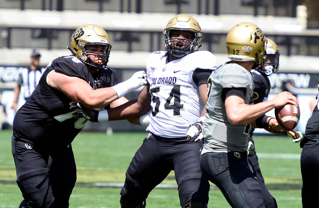 . Boulder, CO - April 27, 2019: Terrance Lang (54) pressures Steven Montez during the 2019 CU Football Spring Game on April 27, 2019. (Photo by Cliff Grassmick/Staff Photographer)