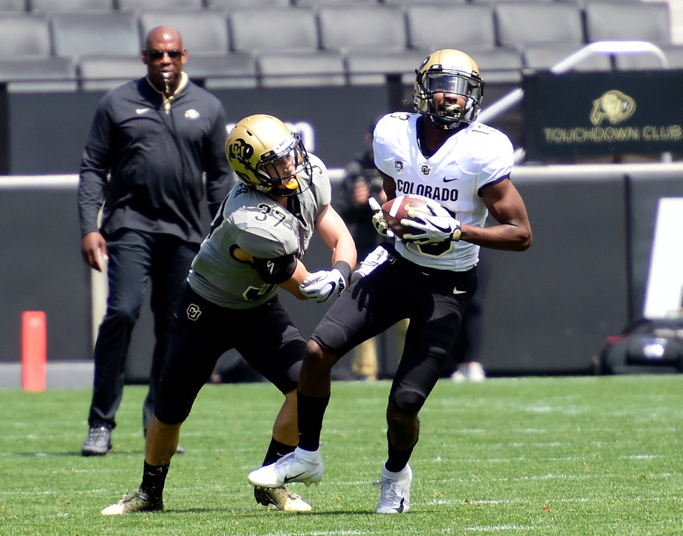 . Boulder, CO - April 27, 2019:  Maurice Bell makes a catch in front of Lucas Cooper during the 2019 CU Football Spring Game on April 27, 2019. (Photo by Cliff Grassmick/Staff Photographer)