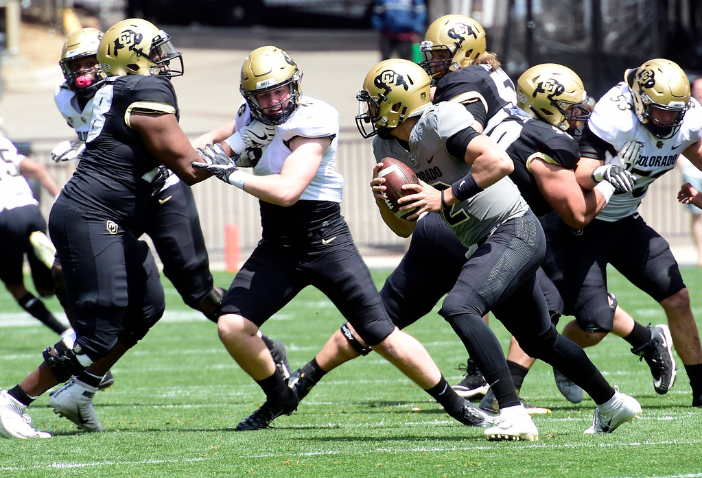 . Boulder, CO - April 27, 2019: Alec Pell, center, has his eyes on Steven Montez during the 2019 CU Football Spring Game on April 27, 2019. (Photo by Cliff Grassmick/Staff Photographer)