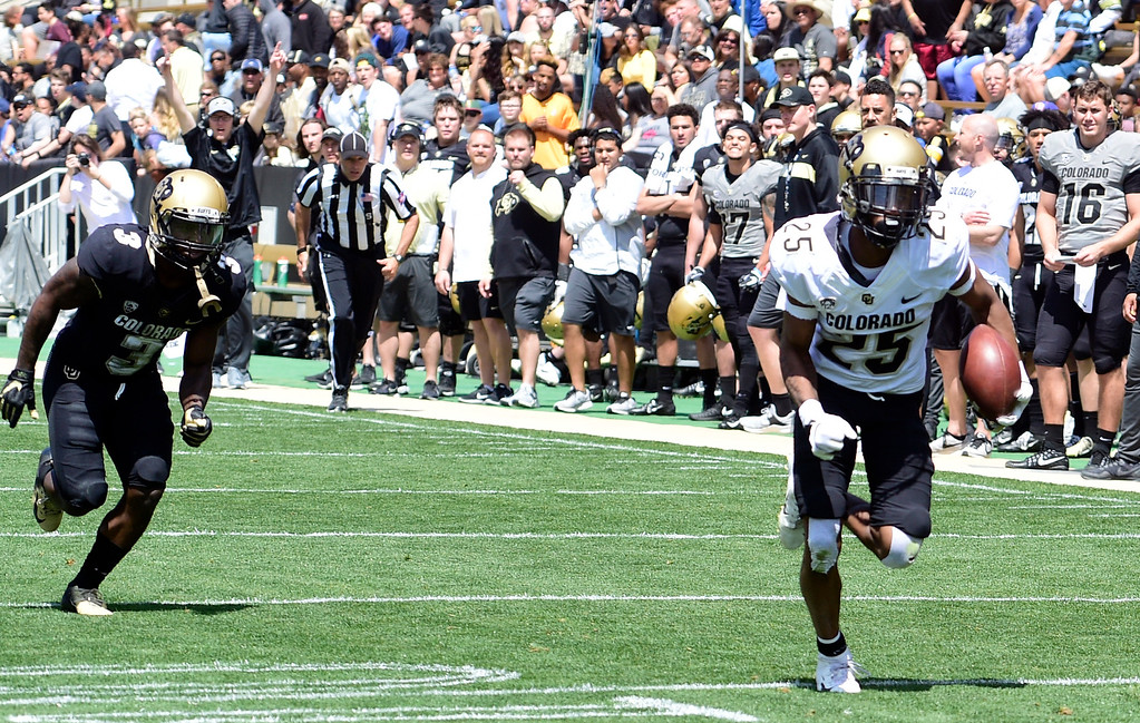 . Boulder, CO - April 27, 2019: Mekhi Blackmon takes off with an interception for a pick 6 during the 2019 CU Football Spring Game on April 27, 2019. (Photo by Cliff Grassmick/Staff Photographer)