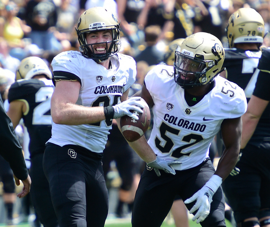 . Boulder, CO - April 27, 2019: Carson Wells, left, and Alex Tchangam, celebrate an interception by Wells during the 2019 CU Football Spring Game on April 27, 2019. (Photo by Cliff Grassmick/Staff Photographer)
