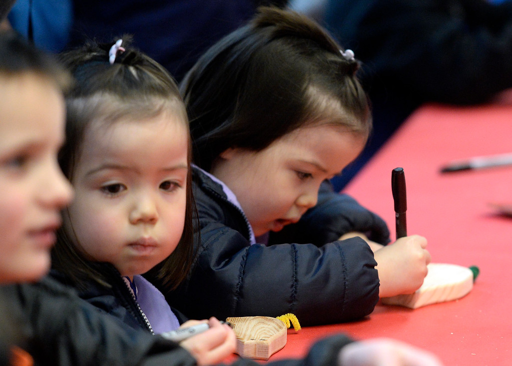 . LONGMONT, CO - February 16, 2019:   Twins Mya and Julia Damon, 3, make a craft at the celebration. The Asian-Pacific Association of Longmont held the annual Chinese New Year Celebration on Saturday at Silver Creek High School. For more photos, go to dailycamera.com. (Photo by Cliff Grassmick/Staff Photographer)