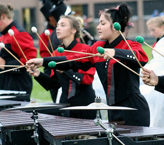 Roger Schneider | The Goshen News Adrienne Lehman, left, and Ary Kehoe, play their marimbas during the NorthWood Red Regiment performance at Concord.