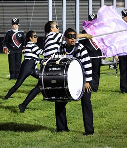 Roger Schneider | The Goshen News Elkhart Memorial's bass drummer Porschia Kemery, performs in costume during the Concord band invitational Saturday night.