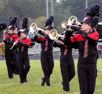 Roger Schneider | The Goshen News NorthWood band members stay in step as they perform during a rain shower Saturday at the Concord invitational.