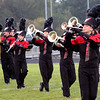 Roger Schneider | The Goshen News<br /> NorthWood band members stay in step as they perform during a rain shower Saturday at the Concord invitational.
