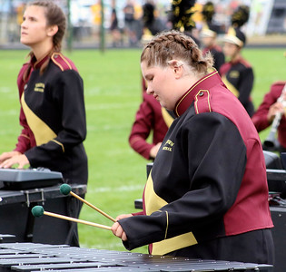 Roger Schneider | The Goshen News Mackenzie Kelly and Riley Horvath  play their instruments for the Jimtown High School Marching Band at the Concord invitational.