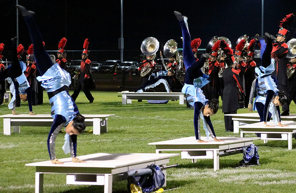 Roger Schneider | The Goshen News<br /> Members of the Goshen color guard perform cartwheels during the band's show Saturday.