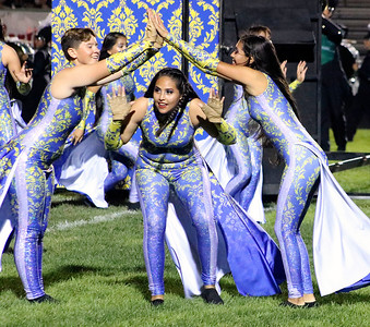 Roger Schneider | The Goshen News Members of the Concord color guard, from left, Ashanti Rogers, America Santos and  Miriam Diaz-Reyes, perform during the Concord band's Saturday night show.