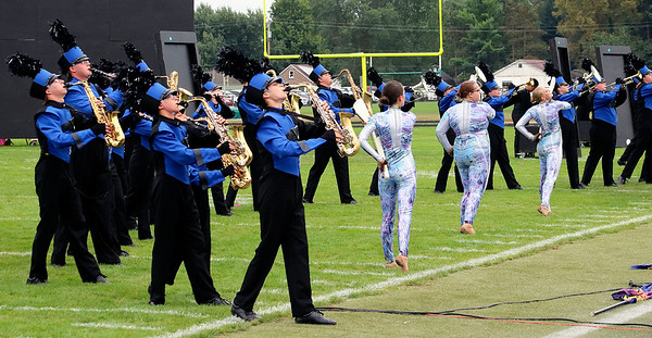 Roger Schneider | The Goshen News<br /> Saxophones, mellophones and trumpets play at the end of the third movement during the Fairfield show.