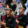 Roger Schneider | The Goshen News<br /> Makayla Smith and Aliyah Gordy march and play for the Jimtown band at the Concord invitational.