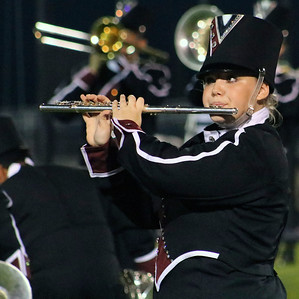 Roger Schneider | The Goshen News Maya Cunningham plays the flute for Elkhart Memorial's Crimson Charger Command.