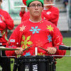 "Roger Schneider | The Goshen News<br /> Kevin Van Lue is decked out in Christmas attire while he plays the drums during the Wawasee Warriors Marching Pride's ""The Grinch Rewrapped"" show Saturday at Concord."