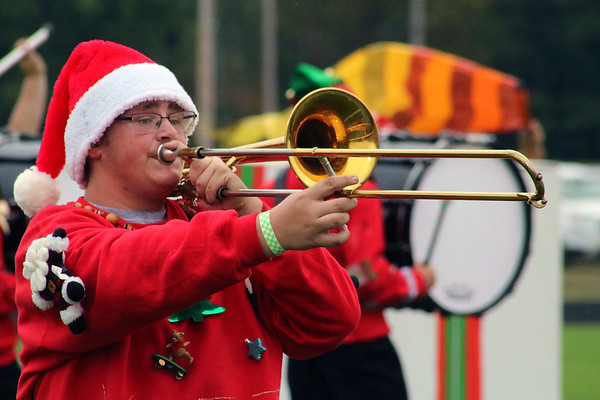 Roger Schneider | The Goshen News<br /> A Wawasee trombonist marches and plays during the Wawasee band's performance Saturday.