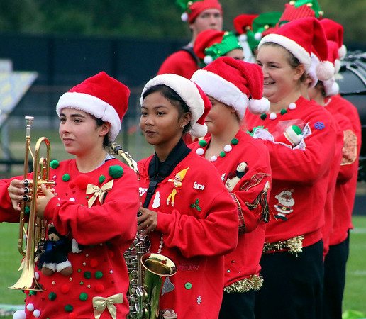 Roger Schneider   The Goshen News<br /> Decked out in holiday costumes, members of the Wawasee band prepare to perform Saturday.