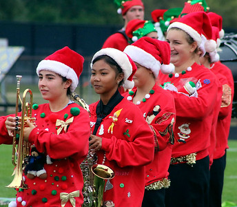 Roger Schneider | The Goshen News Decked out in holiday costumes, members of the Wawasee band prepare to perform Saturday.