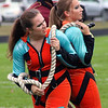 "Roger Schneider | The Goshen News<br /> Jimtown colorguard members Jordan Reaves and Jocelyn Saunders, use a heavy rope as part of the props in the ""Moving Mountains"" show."