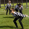 "Roger Schneider | The Goshen News<br /> Members of Elkhart Memorial's color guard perform during the band's show titled ""The Heist."""
