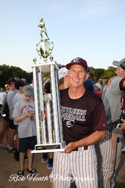 16 year head coach Mike Roberts holding the Arnold MyCock Cape Cod League championship trophy emblematic of winning the 2019 Cape League title.