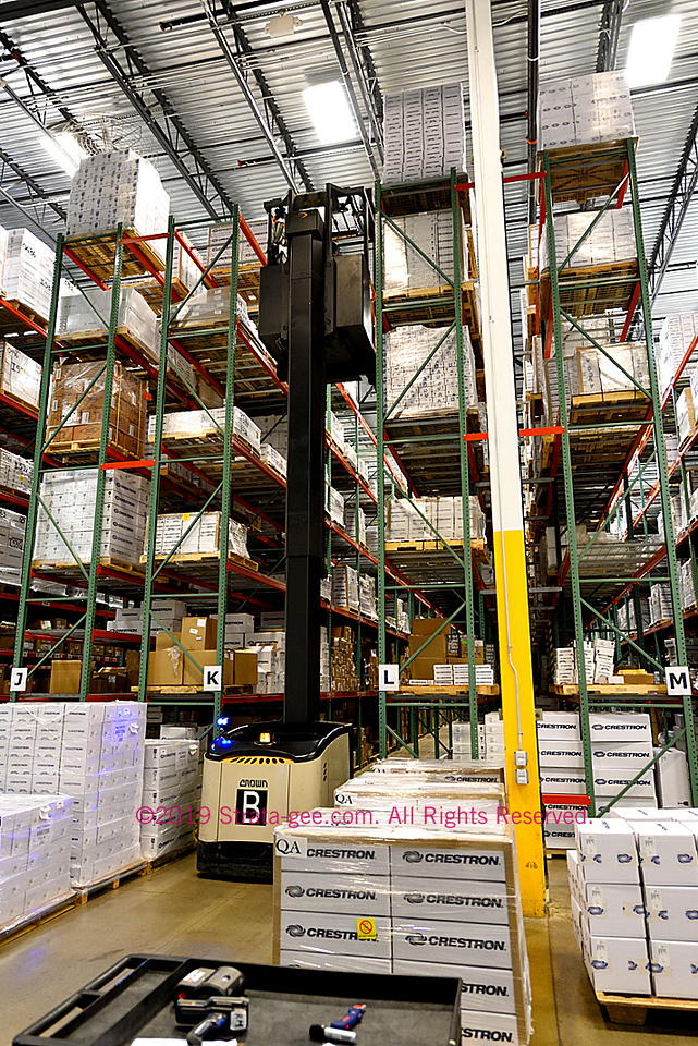 Crestron's warehouse uses closely spaced, six level racks