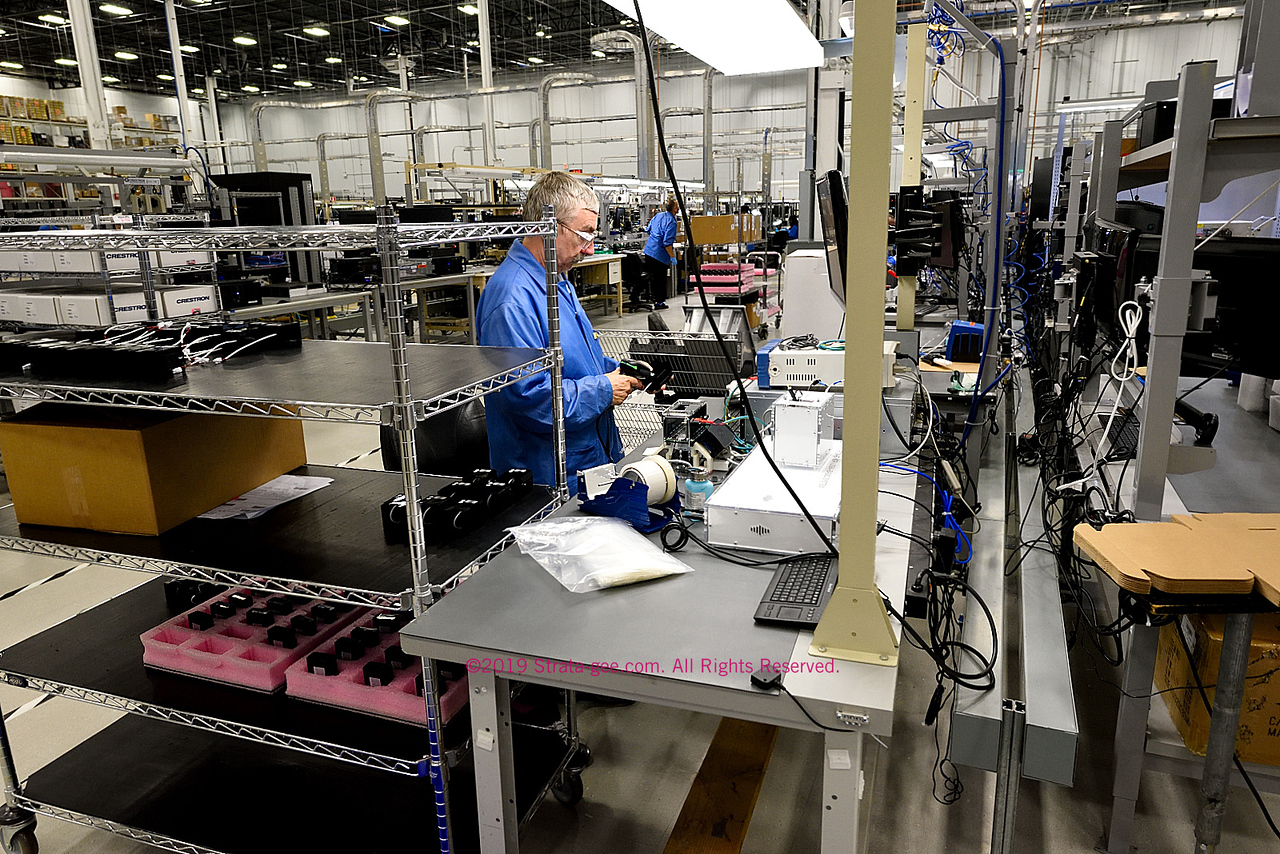 This worker is testing a component for one of the 24 production lines
