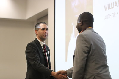 Greg Hayes, executive director of the WASD Education Foundation, welcomes keynote speaker William Kamkwamba to the stage.