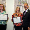 35-year employees Dina Holmes, Financial Aid, and Kim Comproski, President's Office, with the president