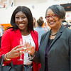 President Katherine Conway-Turner toasting with a graduating senior at the Commencement Preview at Buffalo State College.